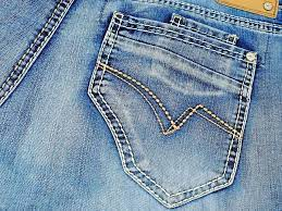 What is the best method to remove paint from jeans?